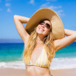 Beautiful Woman at the Beach — Stock Photo #13987751