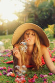 Beautiful Woman Blowing Bubbles — Stock Photo