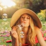 Beautiful Woman Blowing Bubbles — Stock Photo #14319847