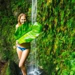 Woman underwaterfall in Hawaii — Stock Photo