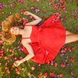 Beautiful Young Woman Lying in Flowers — Stock Photo #14319801
