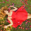 Beautiful Young Woman Lying in Flowers — Stock Photo #14319805