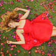 Beautiful Young Woman Lying in Flowers — Stock Photo