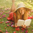Young Woman Reading Book Outside — Stock Photo #14319829