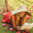 Young Woman Reading Book Outside — Stock Photo #14319833