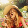 Beautiful Woman Blowing Bubbles — Stock Photo #14319837
