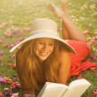 Young Woman Reading Book Outside — Stock Photo #14319841