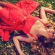 Beautiful Young Woman Lying in Flowers — Stock Photo #14319861