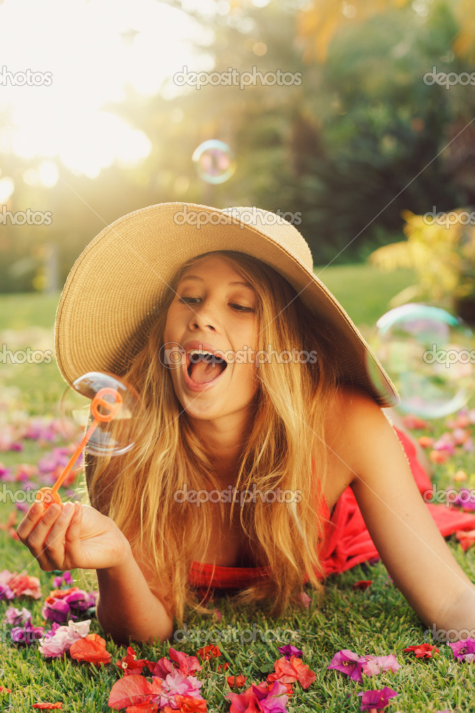 Beautiful Young Woman Blowing Bubbles — Stock Photo #14319837