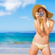 Beautiful Woman at the Beach with Camera — Stock Photo #14320459