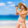 Beautiful Woman at the Beach with Camera — Stock Photo #14320467