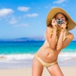 Beautiful Woman at the Beach with Camera — Stock Photo #14320481