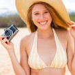 Beautiful Woman at the Beach with Camera — Stockfoto #14320629