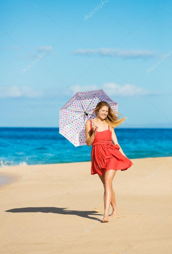 Beautiful Young Woman Walking on Tropical Beach with Colorful Umbrella — Stock Photo #14320001