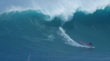 Professional windsurfer rides a giant wave — Stock Video