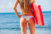 Young Bbeautiful in Bikini at the Beach with Boogie Board — Stock Photo