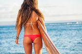 Beautiful surfer girl in sexy bikini — Stock Photo