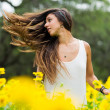Woman in field of flowers - Stock Photo