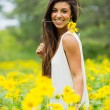 Woman in field of flowers — Stock Photo #21906571