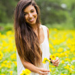 Woman in field of flowers — Stock Photo