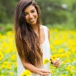 Stock Photo: Woman in field of flowers