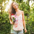 Young Woman with Flowers — Stockfoto