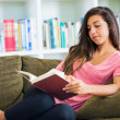Happy young woman reading a book — Stock Photo