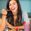Woman eating Waffles with Fresh Fruit — Stock Photo #30916593