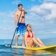 Stock Photo: Couple Sharring Stand Up Paddle Board
