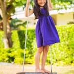 Girl Playing on Swing Set — Stock Photo