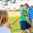 Kids playing Tug of War — Stock Photo