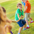 Kids playing Tug of War — Stock Photo #31190023