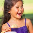 Girl Earting Cake — Stock Photo #31190733