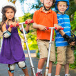 Kids with Skate Boards and Scooters — Stock Photo #31190871