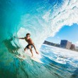 Stock Photo: Surfer Gettting Barreled