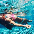Woman floating in Natural Pool — Stock Photo