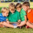 Kids using tablet computer — Stock Photo