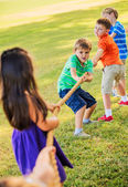 Kids Playing Tug of War On Grass — Stock Photo