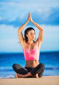 Woman practicing yoga at sunset — Stock Photo