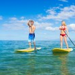 Stock Photo: Couple Stand Up Paddle Surfing In Hawaii