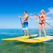 Couple Stand Up Paddle Surfing In Hawaii — Stok fotoğraf