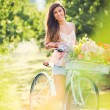 Beautiful young woman on bike — Stok fotoğraf