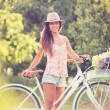 Beautiful young woman on bike — Stock Photo #32589829