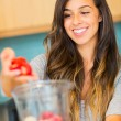 Stock Photo: Woman Making Fresh Fruit Smoothie