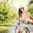 Beautiful young woman on bike — Stock Photo #32589905
