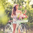 Beautiful young woman on bike — Stock Photo #32589981