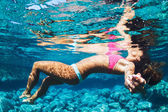 Woman Floating in Tropical Water — Stock Photo