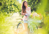 Beautiful young woman on bike — Stock Photo