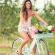 Beautiful young woman on bike — Stock Photo #32590143