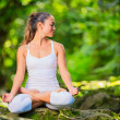 Beautiful Young Woman in Lotus Position — Stock Photo